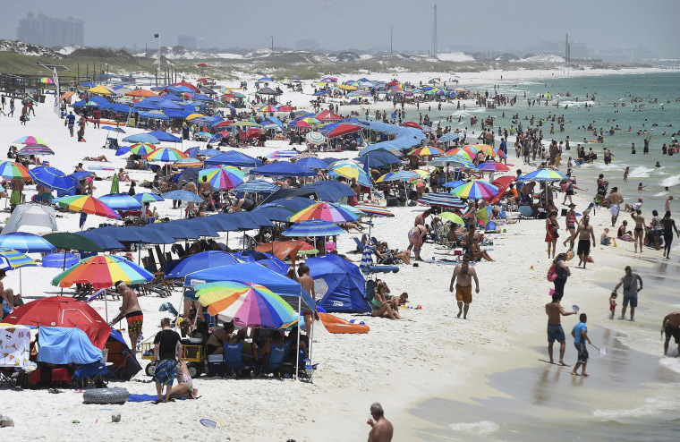 Image: People crowd the beach on Okaloosa Island in Fort Walton Beach