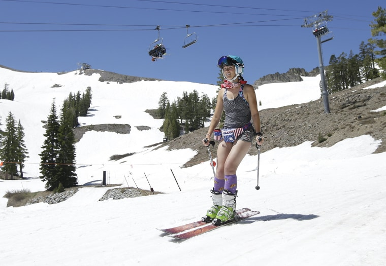 Image: A skier wears shorts and a tank top at Squaw Valley