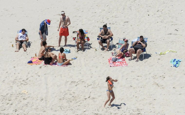Image: New Jersey Gov. Chris Christie, right, uses the beach with his family and friends at the governor's summer house at Island Beach State Park in New Jersey.