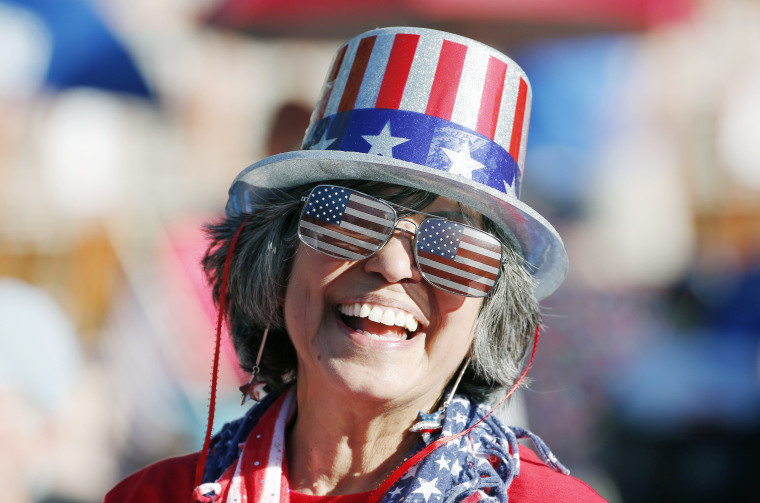 Image: Maryann Rollings, of Bolton, Mass., wears patriotic gear before rehearsal for the annual Boston Pops Fireworks Spectacular