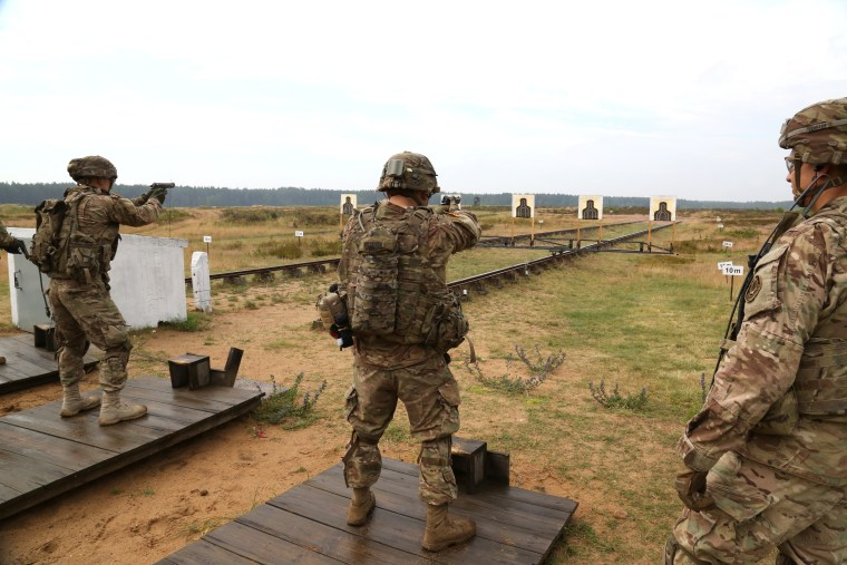 Image: During training at an army base near Orzysz, Poland, U.S. soldiers fire small arms at targets.