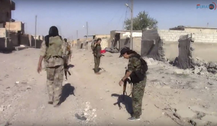 Image: U.S.-backed Syrian Democratic Forces (SDF) fighters in the eastern side of Raqqa, Syria
