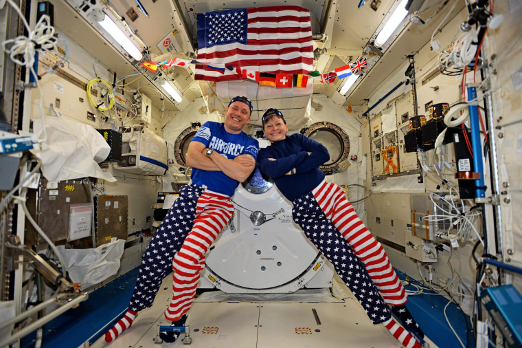 Image:  NASA astronauts Jack Fischer and Peggy Whitson celebrating the Fourth of July from over 250 miles above Earth