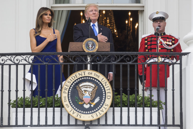 Image: President Trump and first lady Melania Trump observe the playing of the national anthem from the Truman Balcony