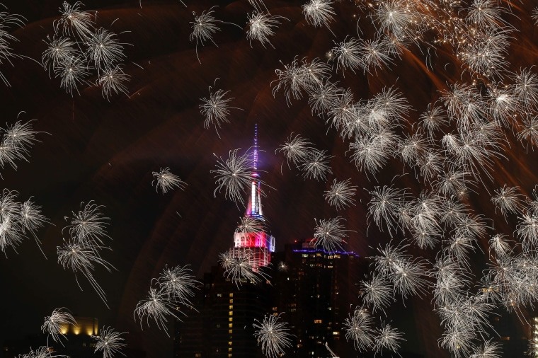 Image: The Empire state Building is seen during the Macy's 4th of July fireworks show from Queens