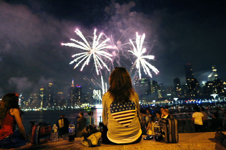 Image: People watch the annual Macy's 4th of July fireworks show from Queens