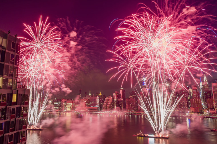 Image: With the New York City skyline in the background, fireworks explode during an Independence Day show over the East River in New York