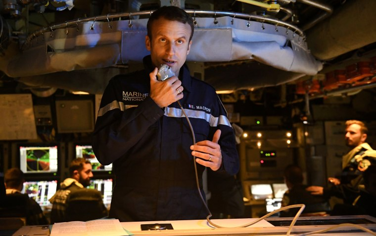 """Image: French president Emmanuel Macron speaks to the Captain and crew of the submarine """"Le Terrible"""" from the operations centre of the vessel, whilst at sea"""