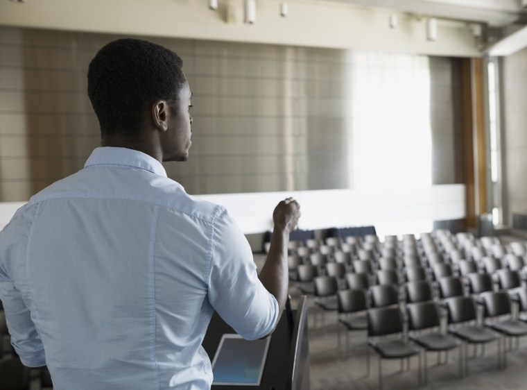 Man rehearsing at podium