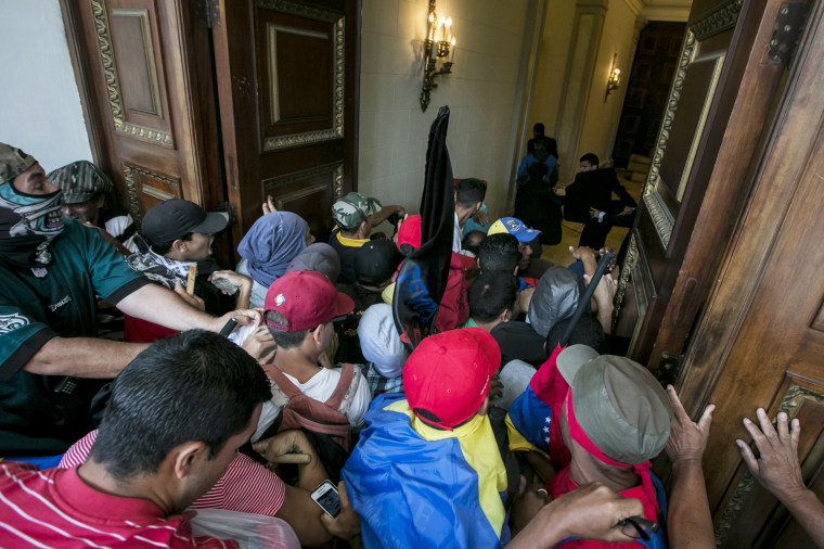 Image: Government supporters break into Venezuelan Parliament and wound deputies