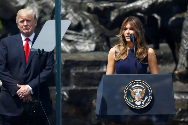 Image: Melania Trump delivers a speech next to President Donald Trump in front of the Warsaw Uprising Monument