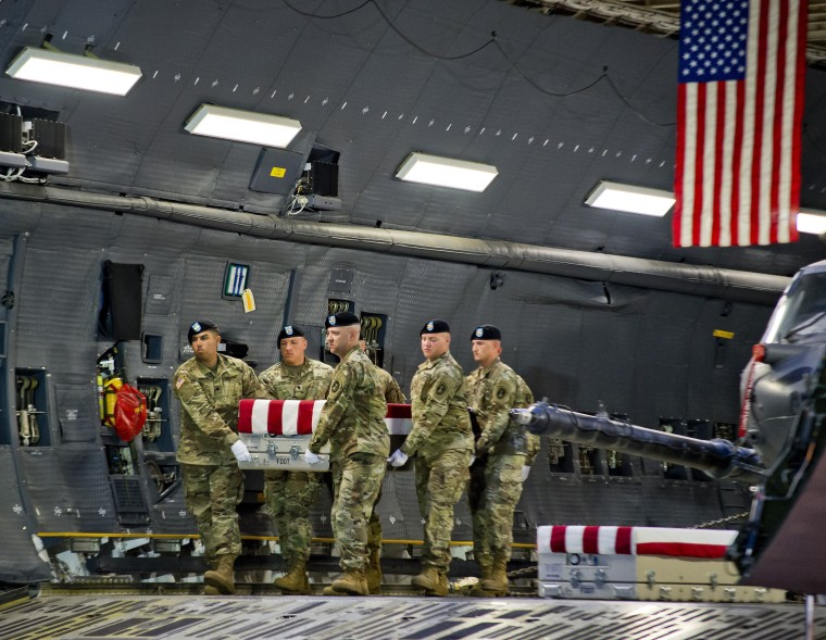 Image: Members of the Old Guard carry the transfer case of U.S. Army Sgt. Eric Houck to the transfer vehicle during the dignified transfer at Dover Air Force Base