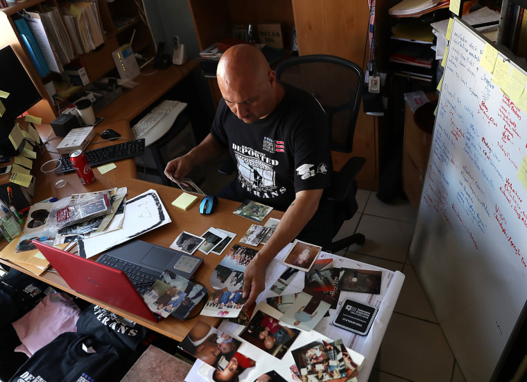 Image: Man sorts old family photos