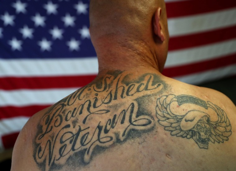 Image: Veteran shows his back tattoo