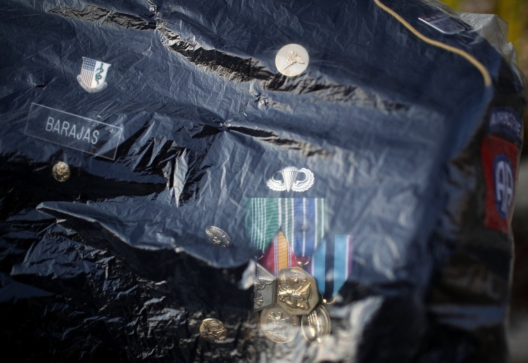 Image: A uniform sits in a plastic bag