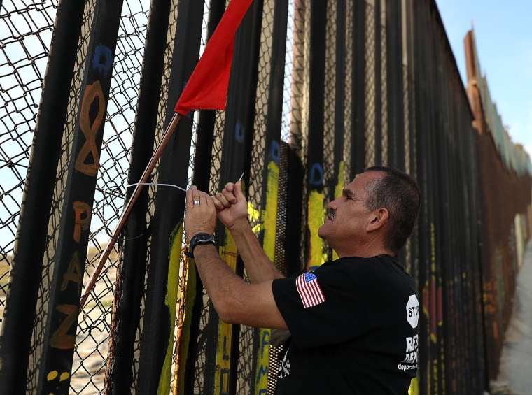 Image: A veteran hangs a flag
