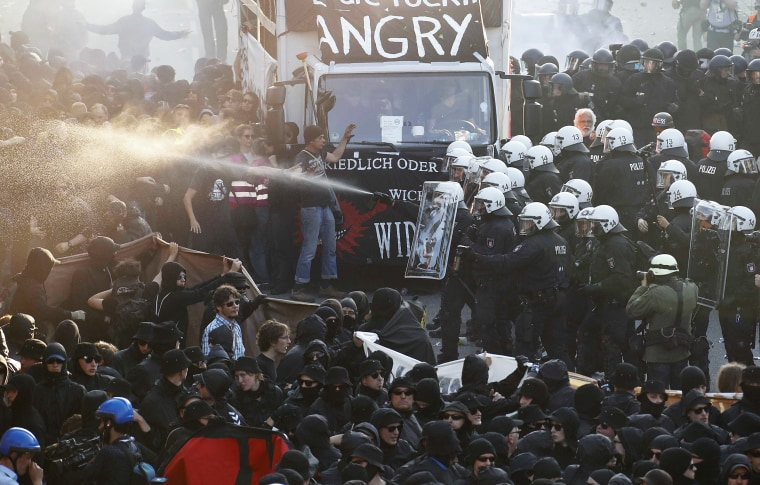 Image: German riot police confront protesters during the demonstrations during the G20 summit in Hamburg
