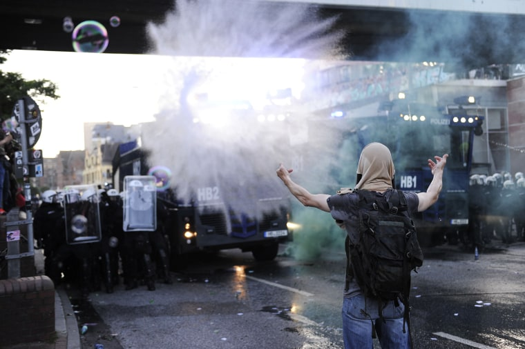 "Image: Riot police use water cannon during the ""Welcome to Hell"" rally"