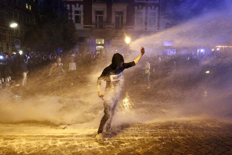 Image: A police water cannon sprays a protester during the demonstrations during the G20 summit in Hamburg