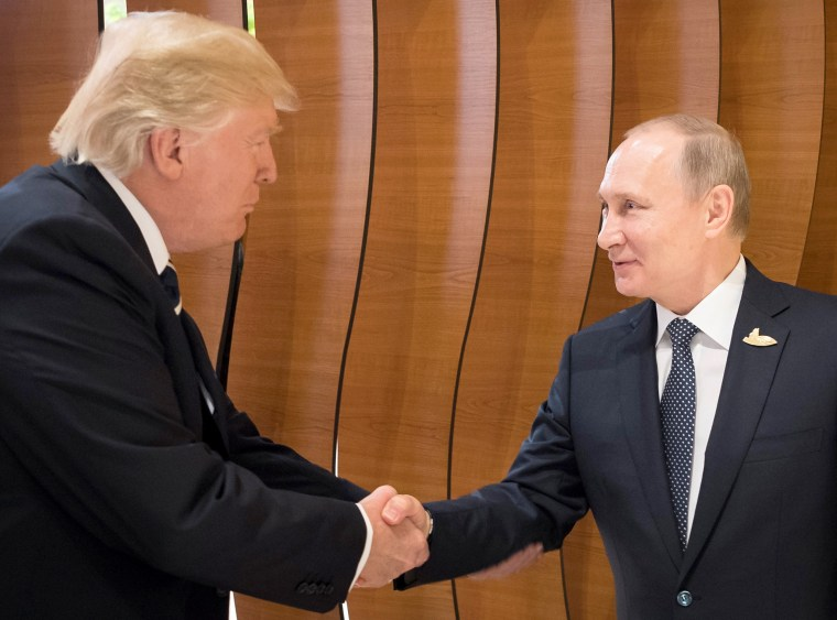 Image: A handout photo made available by the German Government on July 7, 2017 of U.S. President Donald J. Trump shaking hands with Russian President Vladimir Putin.