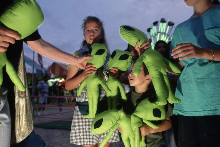Youngsters Receiving Stuffed Alien Toys at Roswell Carnival