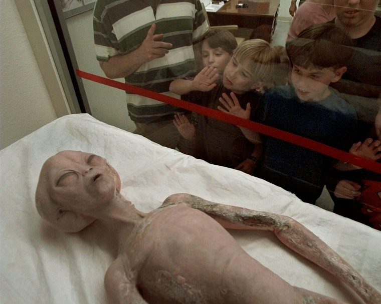 Children look at a model of an alien on display at the UFO Museum and Research Center in Roswell, New Mexico.