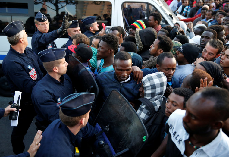 Image: French police evict thousands of migrants