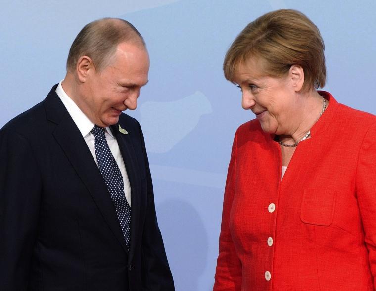 Image: Vladimir Putin, Angela Merkel