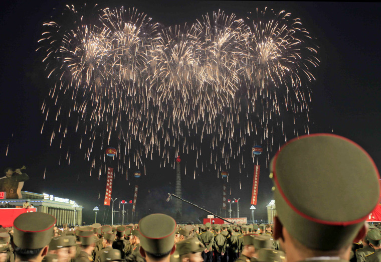 Image: Soldiers watch fireworks in Kim Il Sung Square in Pyongyang