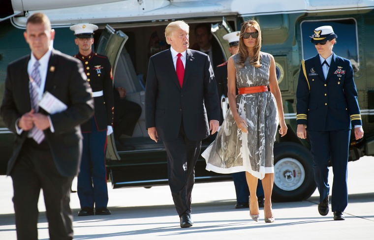Image: US President Donald Trump and US First Lady Melania Trump make their way from Marine One to board Airforce One