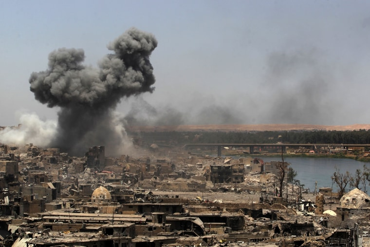 Image: Smoke is seen over Mosul Sunday after an airstrike by U.S.-led forces.