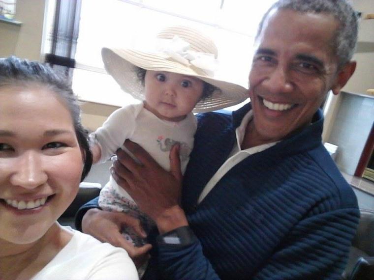 Image: Jolene Jackinsky, left, takes a selfie with her daughter Giselle and former U.S. President Barack Obama at Anchorage International Airport in Alaska.