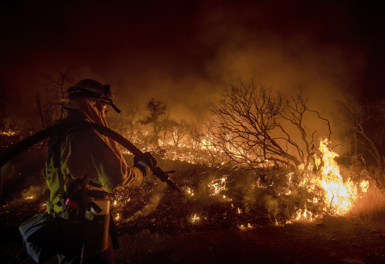Image: Firefighter Kern Kunst battles the Wall fire near Oroville, California