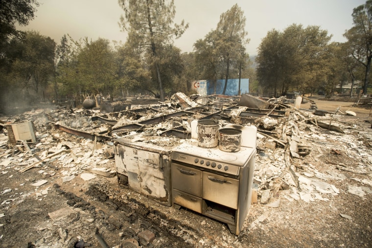 Image: A stove stands in front of a structure leveled by a wildfire near Oroville