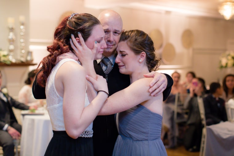 Dad dying of cancer dances with his daughters at friends' wedding