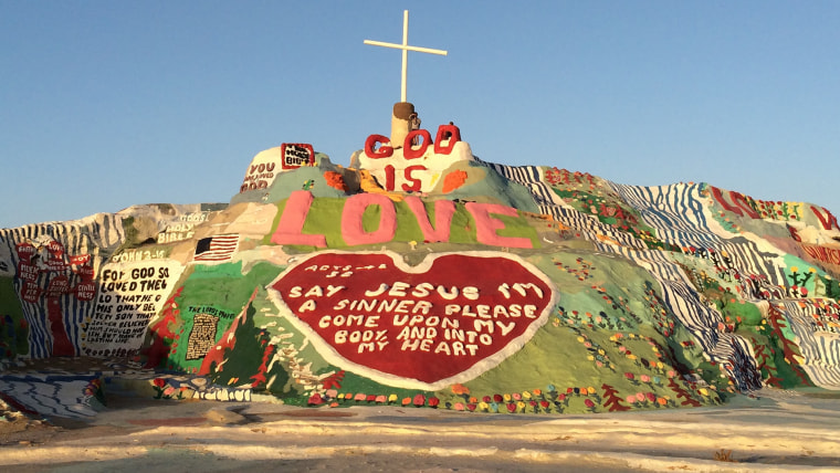 Salvation Mountain is the life's work of Leonard Knight, who had a religious awakening in 1967. The desert artwork, located about 90 miles from Palm Springs, California, has been maintained by volunteers since Knight's death in 2011.