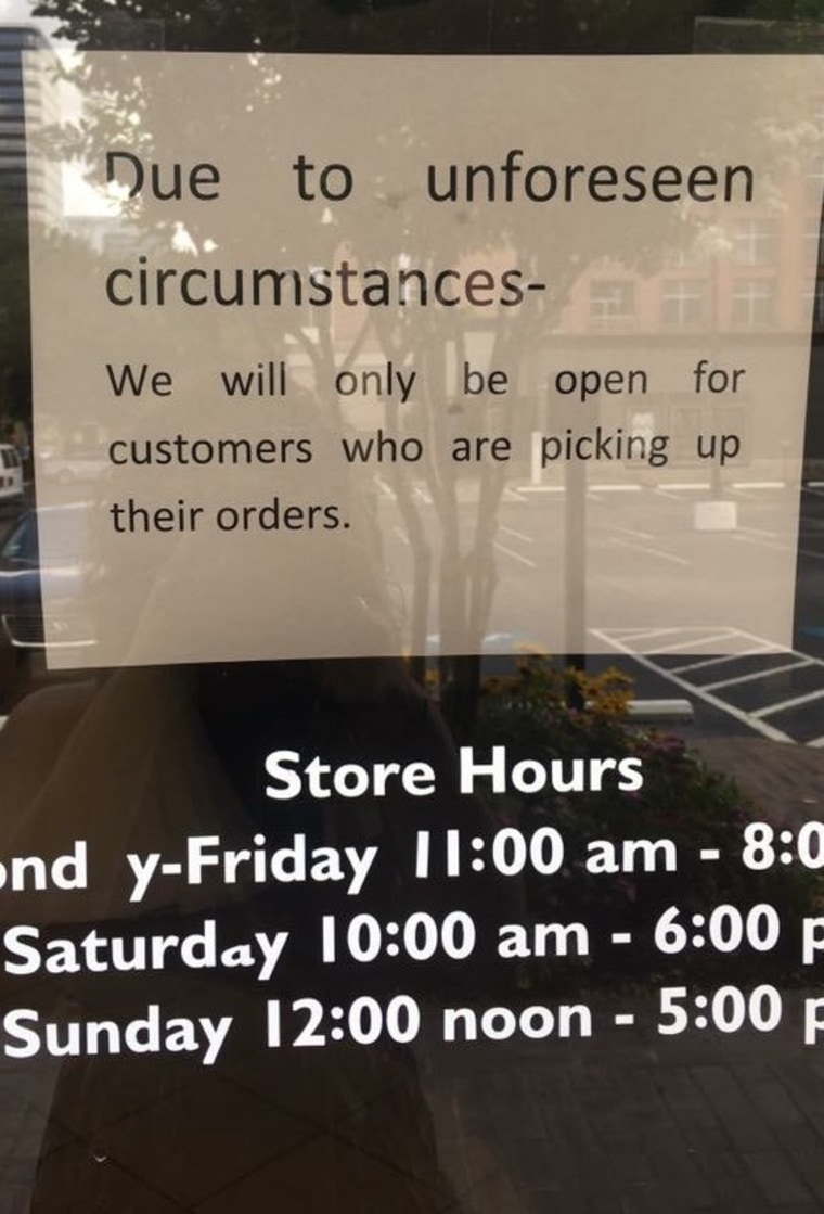 In Houston, Cyndi Cervera Whitten raced to the Alfred Angelo store where she bought her daughter's dress. This sign was on the door.