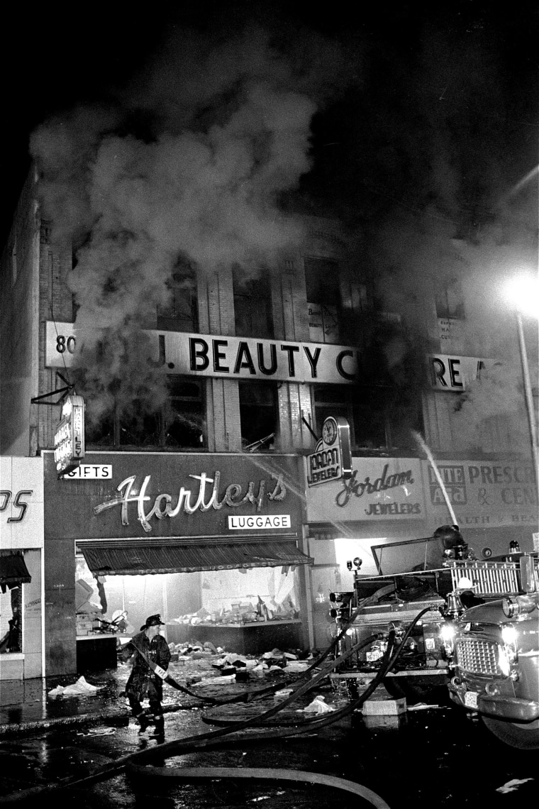 Image: Firemen spray water on burning buildings early July 14, 1967 on Broad Street in Newark, N.J