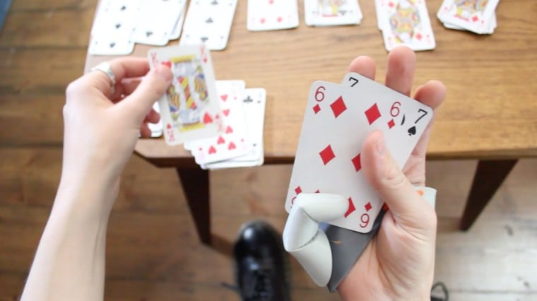 Using the third thumb while playing cards
