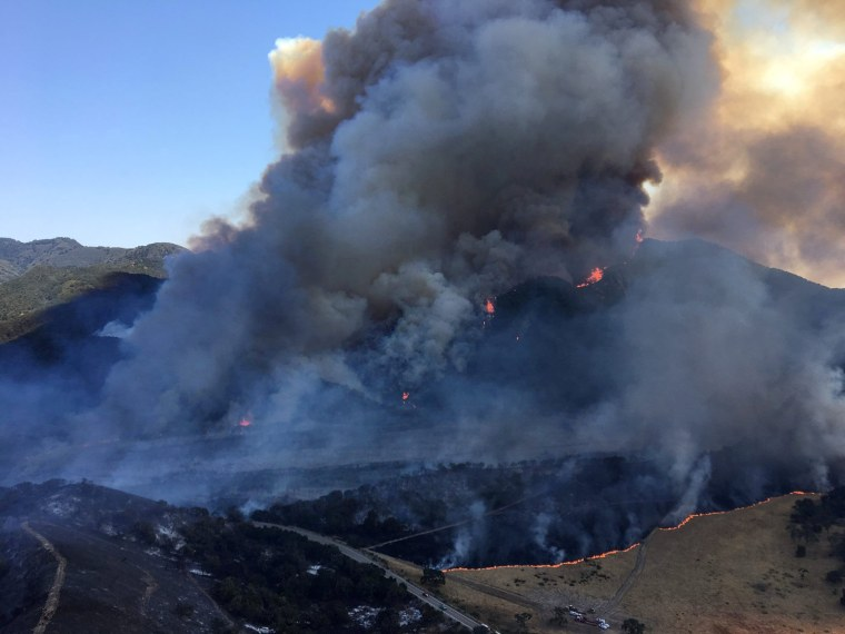 Image: Smoke rises from the Whittier Fire near Santa Barbara, California