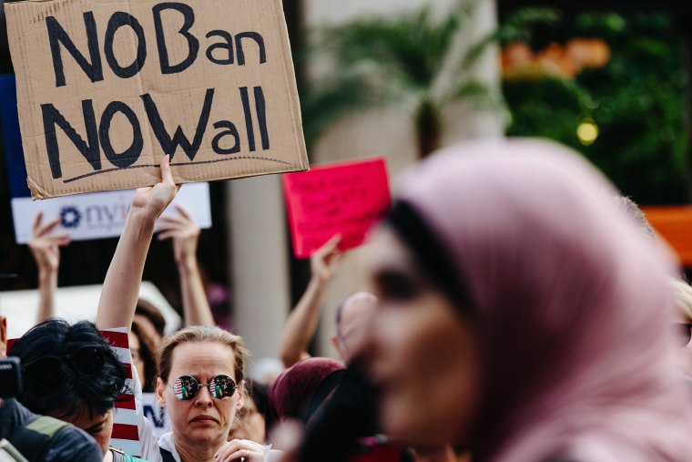 Image: People participate in a rally to protest the separation of families under President Donald Trump's travel ban