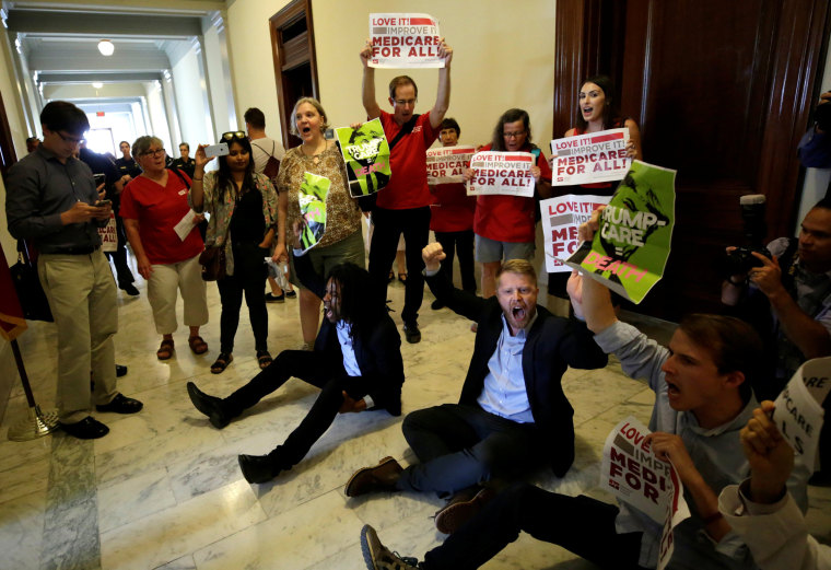 Image: Healthcare activists protest to stop the Republican health care bill at Russell Senate Office Building in Washington