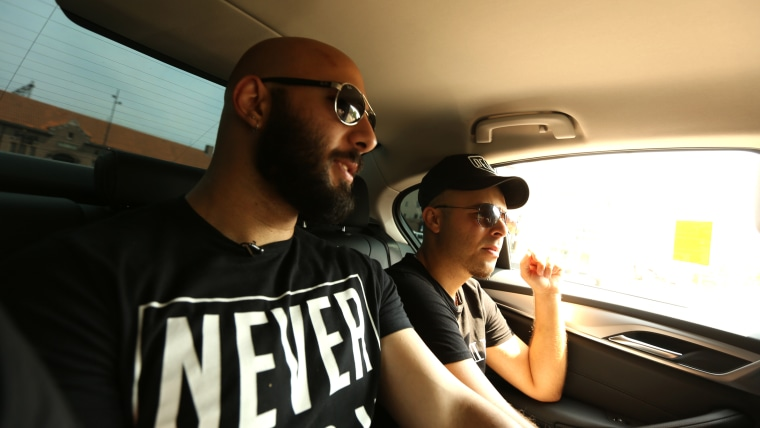 Image: Adel Saflou and his assigned social worker Salim take a taxi en route to Adel's newly assigned home in Deventer, Netherlands