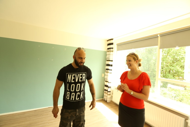 Image: Adel Saflou inspects his new apartment, his first home as an adult