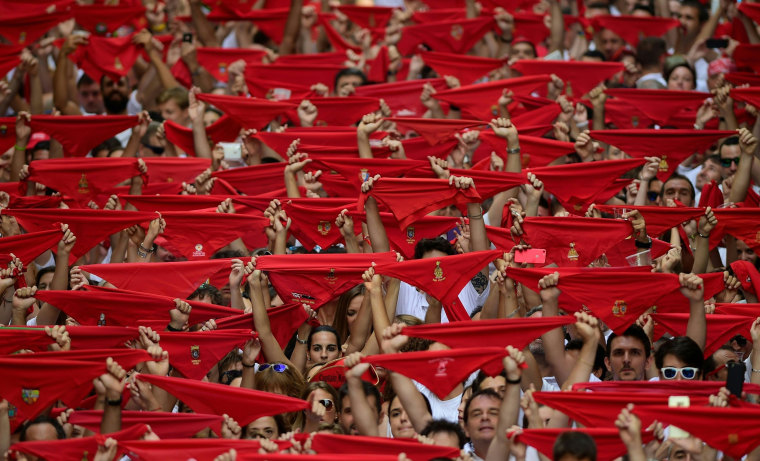 Image: Participants hold red scarves
