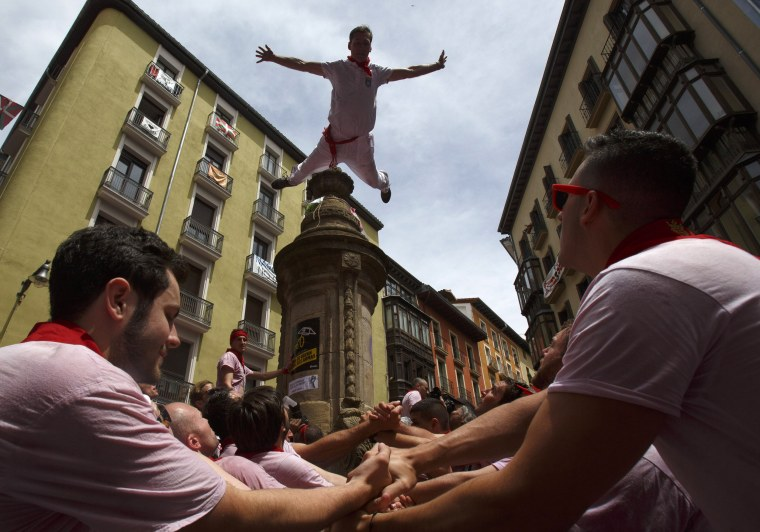 Image: A man jumps from a fountain