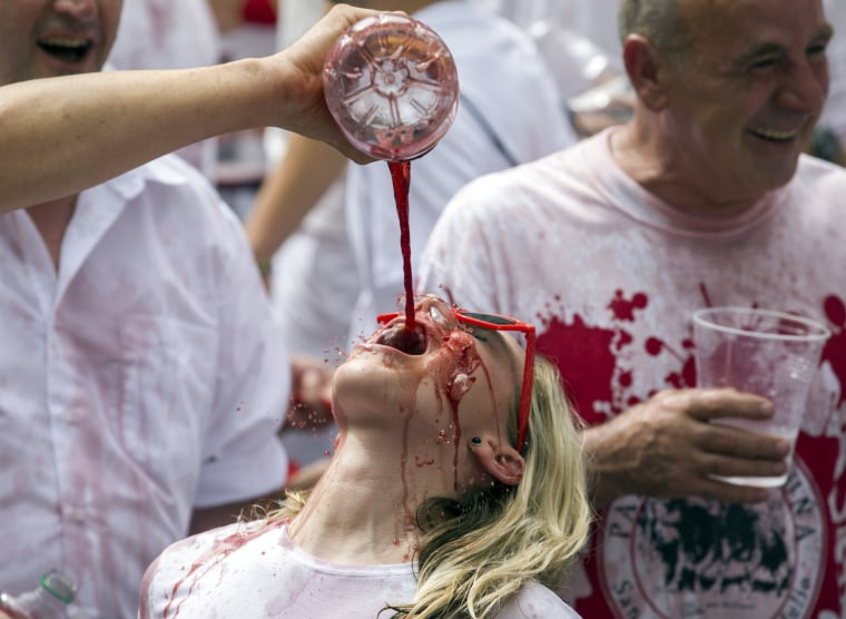 Image: A woman has sangria poured on her
