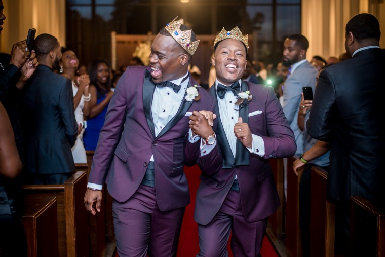 Adrian Homer, left, and Harrison Guy during their wedding ceremony at the University of Houston's A.D. Bruce Religion Center on April 15, 2017.