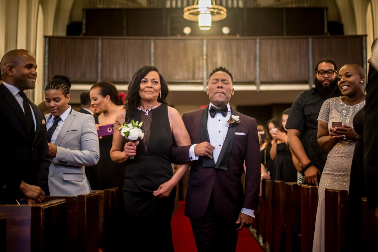Harrison Guy, left, and his mom walk down the aisle at his wedding to Adrian Homer on April 15, 2017.