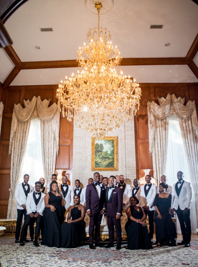 The wedding party of Adrian Homer, center left, and Harrison Guy, center right, included six of their fraternity brothers from Delta Phi Upsilon.